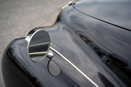 Imperia, Italy - May 17, 2019: Close up detail of a Classic car parked in a street in Imperia during raid of vintage cars