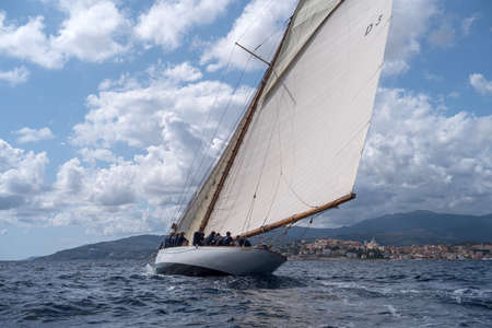 Imperia, Italy - September 7, 2019: The Tuiga sailboat, flagship of the Monaco Yacht Club, during racing in Gulf of Imperia. Established in 1986, the Imperia Vintage Yacht Challenge Stage is a of the most important event in sailing the Mediterranean dedic