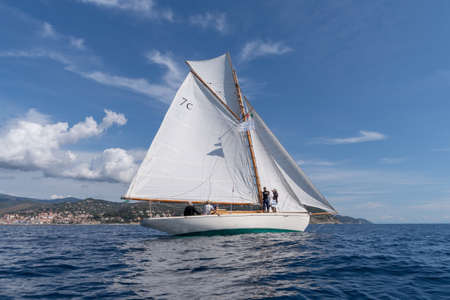 Imperia, Italy - September 7, 2019: Lulu sail yacht, built in 1897, is the oldest French classic yacht, during regatta in Gulf of Imperia. Established in 1986, the Imperia Vintage Yacht Challenge Stage is a of the most important event in sailing the Medit