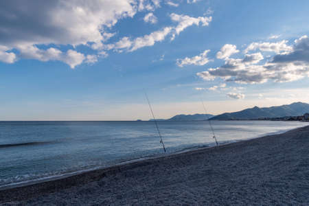 Ligurian Riviera near Finale Ligure, Province of Savona, view of beach and mountain side 写真素材