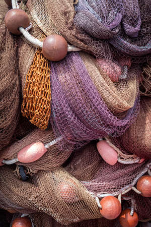 Fishing nets and floats piled up