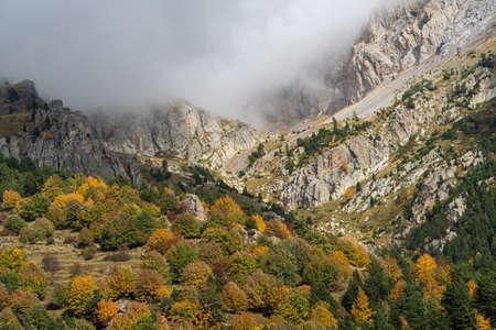 Fog revealing Ligurian Alps mountain range, Piedmont region, Province of Cuneo, north-western Italy