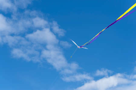 Low angle view of kite flying in cloudy sky Reklamní fotografie