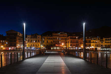 Alassio, Italy - February 26, 2020: View of Alassio from a pier in the night Editorial