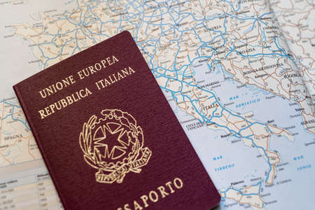 Italian passport with European highway routes map. Close-up view