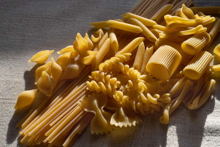 Assortment of uncooked dry pasta of differing types