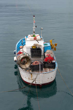 High angle view of fishing boat moored in the small port of Imperia, Liguria, Italy