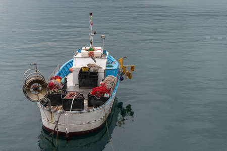 High angle view of fishing boat moored in the small port of Imperia, Liguria, Italy Standard-Bild
