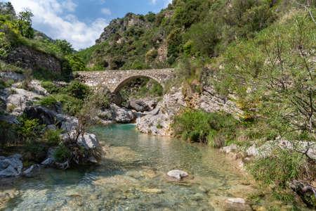 Arch bridge in mountains, Nervia valley, Ligurian Alps, Rocchetta Nervina municipality, Province of Imperia, Italy