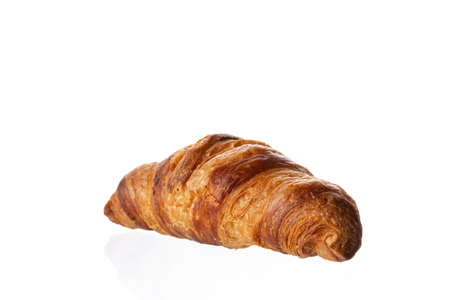Classic french croissant on a white background. Homemade baking.
