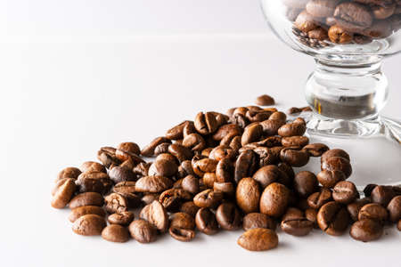 Coffee beans on a white background. Three coffee beans. Fried arabica beans. 免版税图像