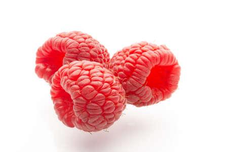 Ripe raspberries on a white background. Berries. Garden raspberries. White background. Red berries. Isolated.