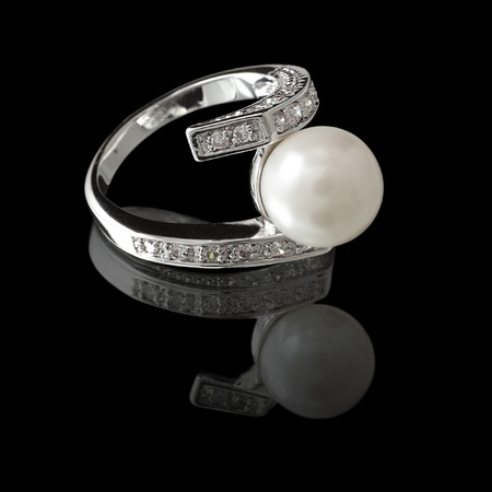 gem: Ring with pearl and diamonds on black background Stock Photo