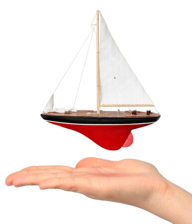 Hand with yacht model Stock Photo