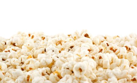 eating popcorn: popcorn grains on the white background  Stock Photo