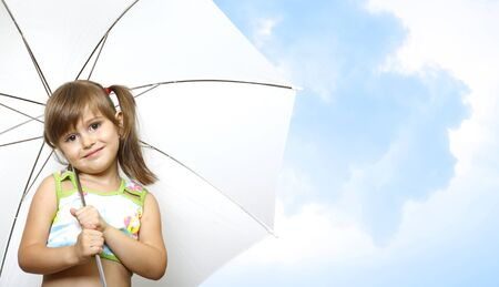 little girl child with umbrella on sky background Stock Photo