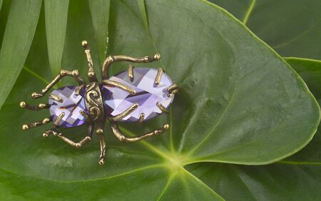vintage brooch with lilac gems on leaves photo