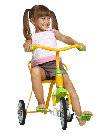 bicyclists: little girl with tails have fun, driving bicycle