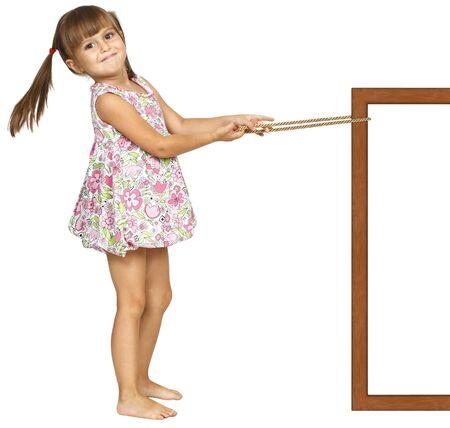 Child girl pulling frame, isolated on white photo