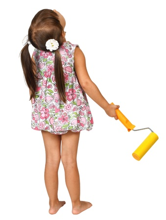 Little girl with roller for paint, back view