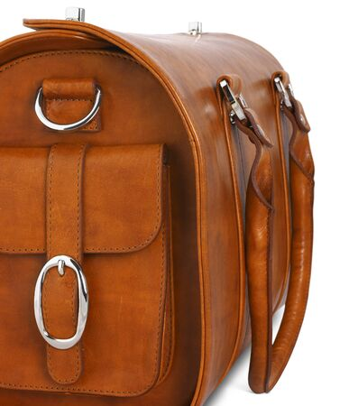 buckled: brown leather bag on white, closeup Stock Photo