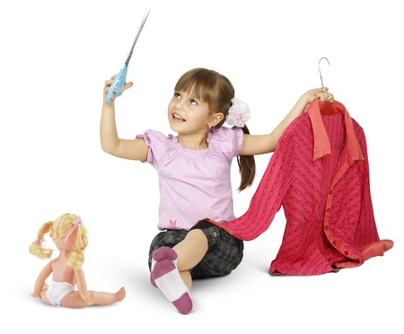 disobedient child: little girl is playing with scissors, sewing