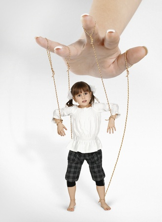 puppet theatre: child girl - puppet , dependence concept Stock Photo