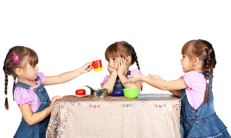 children playing with plastic tableware, twins  Stock Photo - 11378660