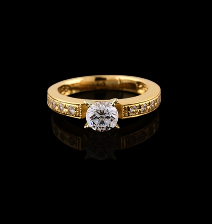 engagement: Gold ring with brilliant isolated on black background  Stock Photo