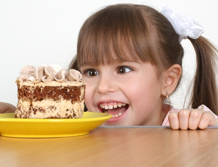 Funny Child girl and cake