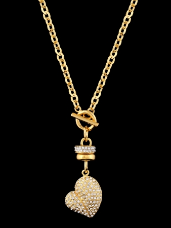 Gold heart with brilliants, pendant isolated on black background photo