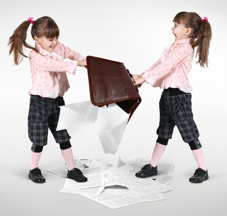 little twin girls fighting and shared suitcase