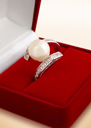 Ring with pearl in gift box, macro photo