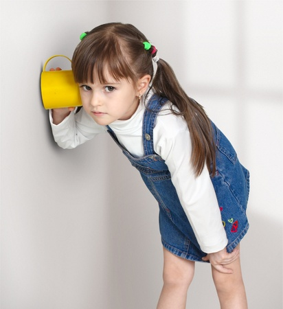noise isolation: Child girl overhear using cup