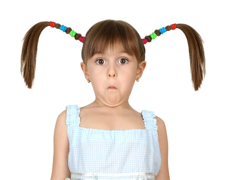 pigtail: Portrait of funny surprised child girl with long tails isolated on white