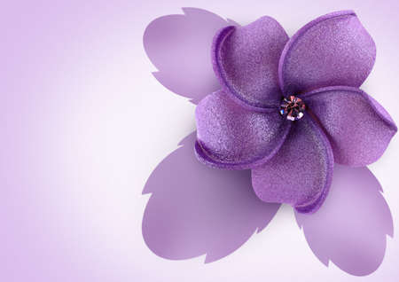 Artificial flower on lilac background photo