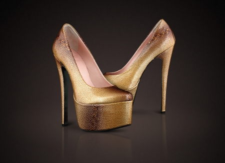 Fashion high heels shoes on chocolate background photo