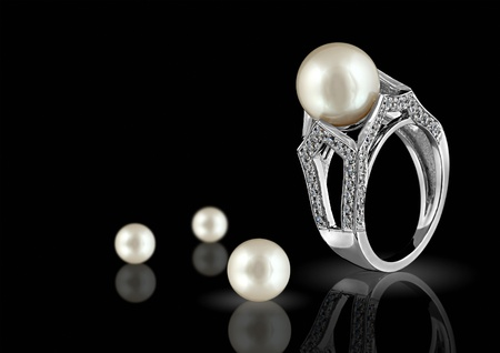 fashion jewelry: Ring with pearl and diamonds on black background Stock Photo