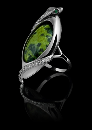 Rings with diamonds and green gem isolated on black background Stock Photo - 16463833