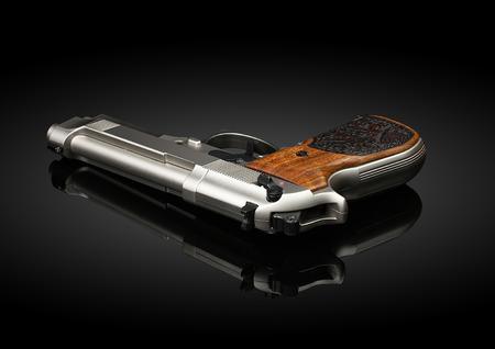 Chromed handgun on black background with reflection Фото со стока