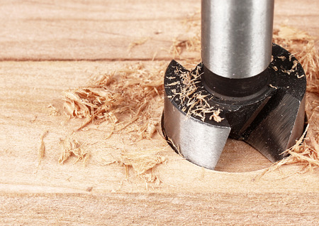 wood processing, auger drilling, close up with copy space