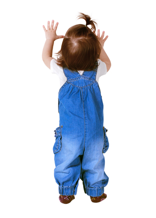 back up: Child stands with hands up, isolated on white. Back view Stock Photo