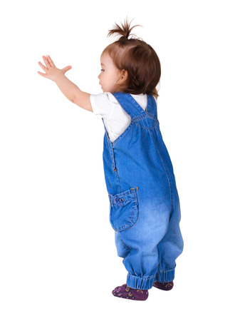 look out: Child stands and look out, isolated on white. Back view Stock Photo