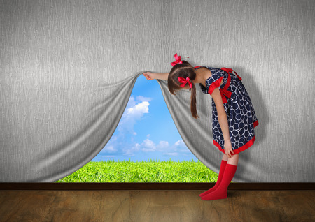 unrealistic: Child raise the wall and look on nature, Stock Photo