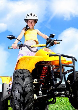 rides: Little Child girl rides on quad