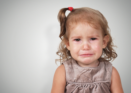 teary: Portrait of crying baby girl, with copy-space Stock Photo