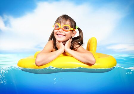 float: Funny child floating inflatable ring at sea, vacation concept