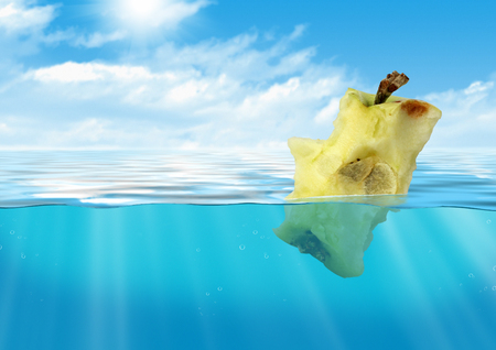 bitten: Bitten apple floating at sea, reservoir pollution concept Stock Photo
