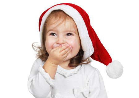 chuckle: Funny child laugh dressed santa hat, cute on white
