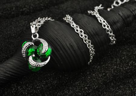 jewel: jewelry pendant with gems on black background